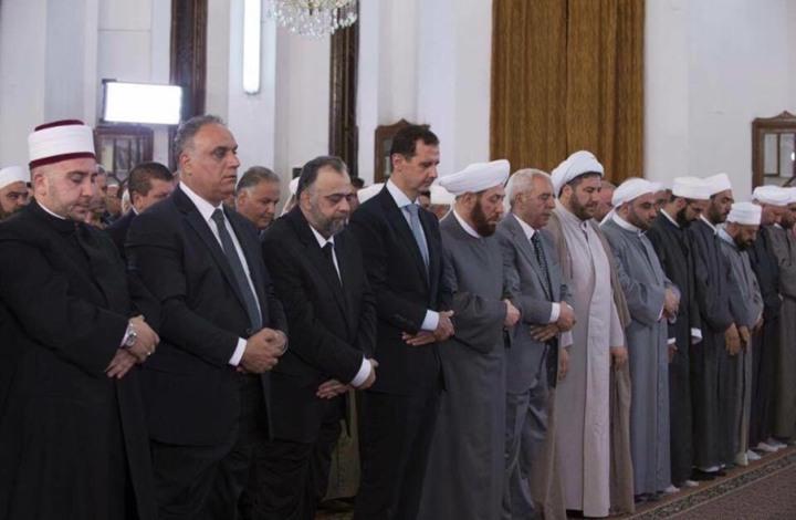 """أزمة بين وزير أوقاف النظام ومخرج بالتلفزيون الرسمي.. وزوجة الأخير تغازل الأسد وتصفه بـ""""المقدس"""""""