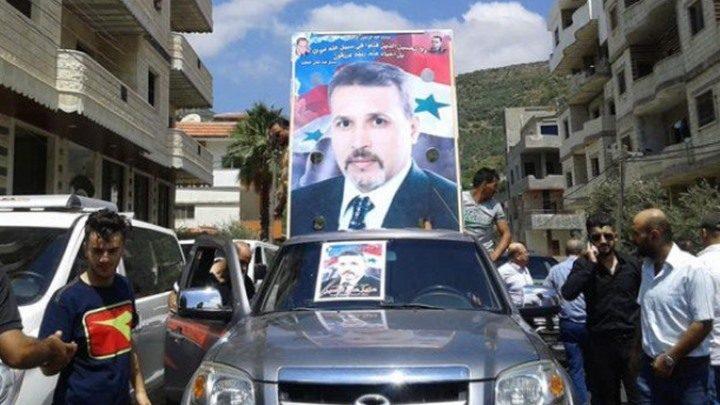 """عضو في """"برلمان الأسد"""" يفجّر مفاجأة عن """"إسبر"""" مخترع البراميل المتفجرة"""
