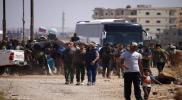 """ميليشيات إيرانية تحتجز قافلة مهجري القنيطرة ودرعا بريف حمص """" فيديو"""""""