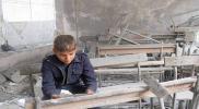 """بعد أن قتلهم على مقاعد الدراسة.. بشار الأسد يصدر قانون """"حقوق الطفل"""""""