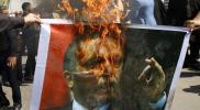 """حارق صورة """"أردوغان"""" بمظاهرات إدلب يتحدث عن ملابسات الواقعة.. ودور """"مخابرات الأسد"""" (فيديو)"""