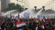 شاهد.. مشهد مؤثر بين رجل أمن عراقي ومتظاهر (فيديو)