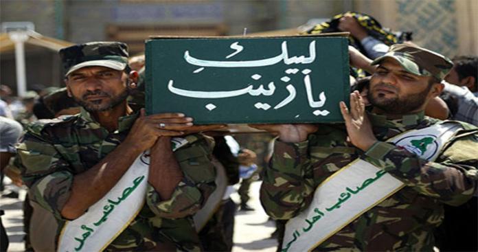 """الميليشيات الشيعية ترفع أخطر راية على مقام """"السيدة زينب"""" في دمشق (فيديو)"""