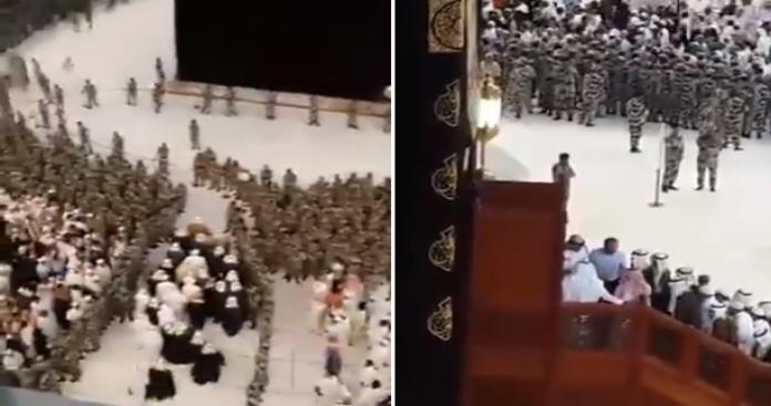 مئات الجنود السعوديين يطوقون الكعبة وشخصية نادرة الظهور تصعد عليها.. وصيحات المعتمرين تتعالى (فيديو)