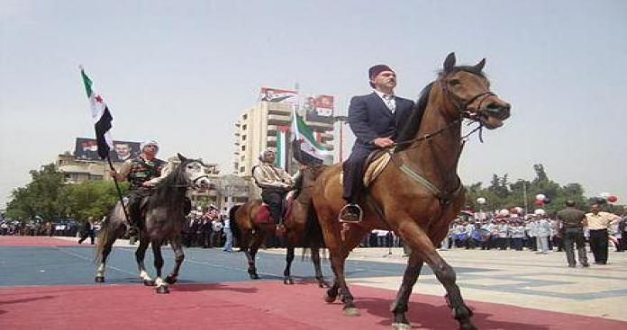 بعد أن جلب الروس والإيرانيين...سخرية واسعة من احتفال نظام الأسد بعيد الجلاء (صور)