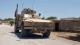 """في مشهد استعراضي باللغة العربية.. ضابط بـ""""جيش الأسد"""" يشتم جنديًا أمريكيًا (فيديو)"""